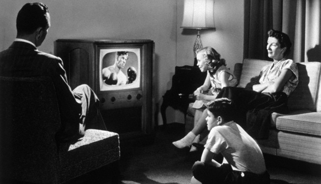 1950s family in living room watching television