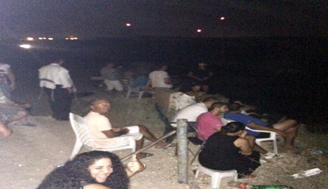 Theater of war: Israelis watch, cheer Gaza airstrikes