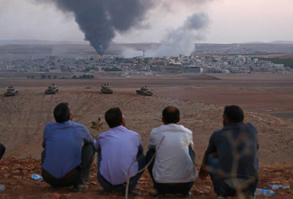 Smoke rises from the clashes in Ayn al-Arab