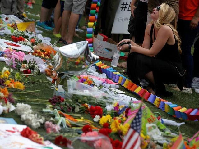 people-mourn-orlando-pulse-terrorist-attack-memorial-reuters-640x480
